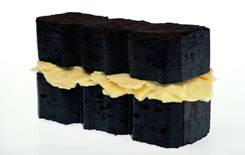 Sean Lynch, Reconstruction of Irish Energies, peat briquettes, butter,original made by Joseph Beuys in 1974 and subsequently exhibited in Rosc '77, Dublin