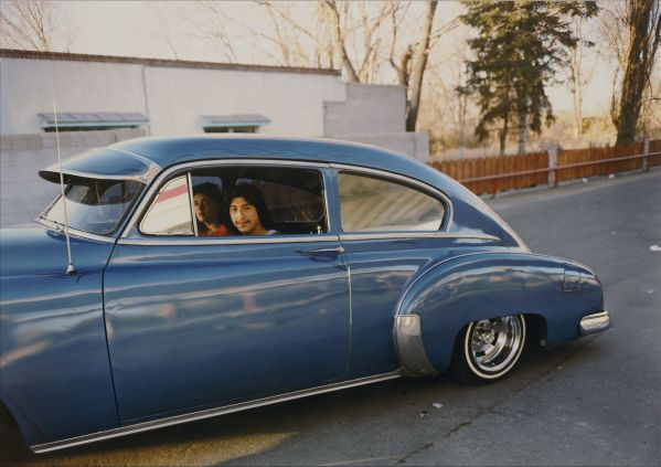 "Meridel Rubenstein, Donaldo Valdez, El guique, '49 Chevy from ""The Lowriders, Portraits from New Mexico,"" 1980, Colour coupler print, 35.6 x 43.2 cm, @ Meridel Rubenstein"