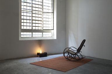 Juliette Blightman, This World is not my home, 2010, chair, rug, window, brazier, fire, dimensions variable. Courtesy of the artist and Galleria Zero, Milan