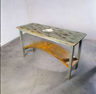 Dorothy Cross, Kitchen Table, 1991, 90 x 162 x 60 cm, Wood, enamel bowl, steel, glass test tube, fossilised shark teeth, Collection Irish Museum of Modern Art, Photo credit: John Kellett